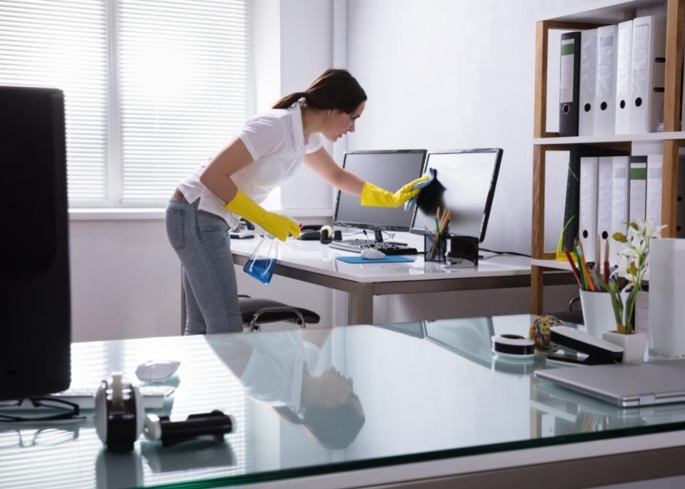 Maid wiping computer screen